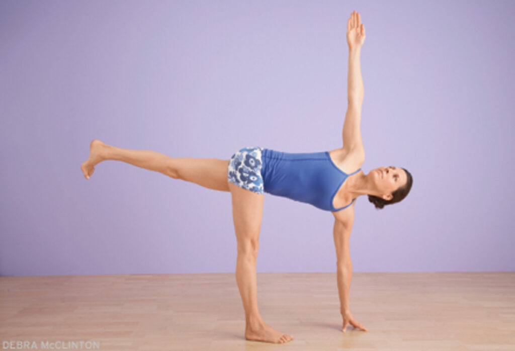 Revolved half moon pose practicing by a girl