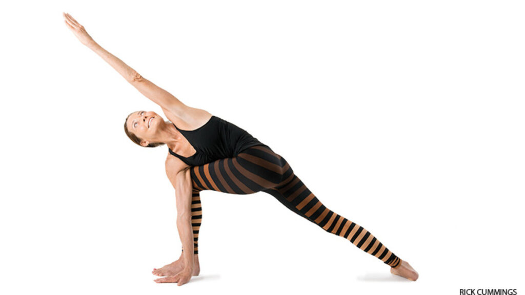 Revolved side Angle Pose practicing image.